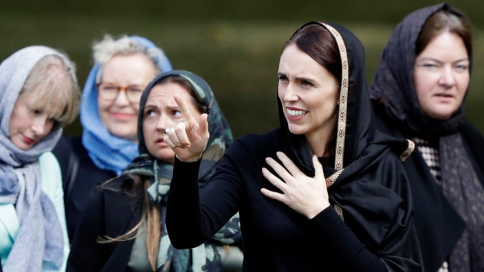 Prime Minister Jacinda Ardern, second right, gestures as she leaves Friday prayers at Hagley Park in Christchurch