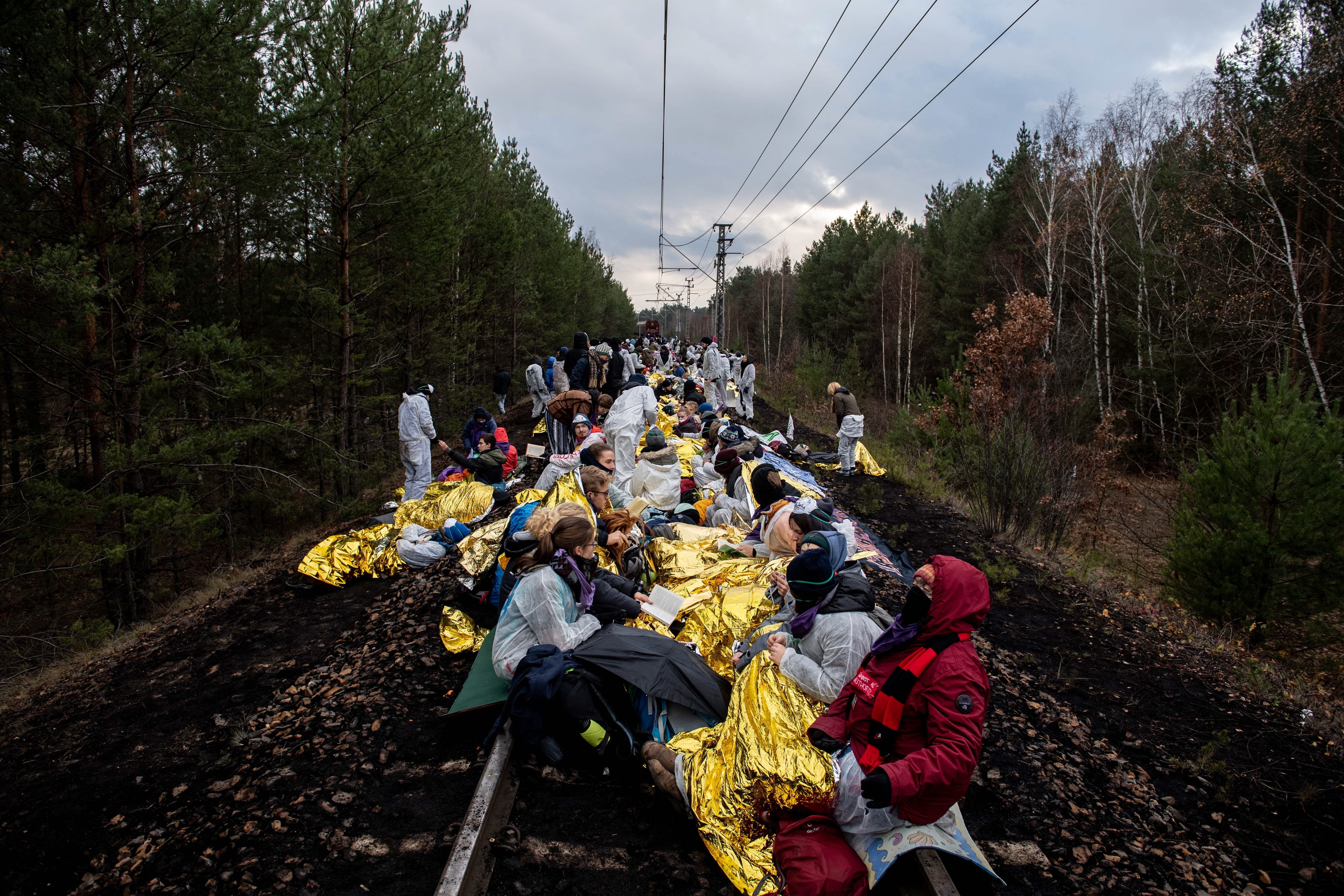 Climate activists block the rail line to the coal-fired power plant Jaenschwalde, near Cottbus in Germany, 30 November 2019.