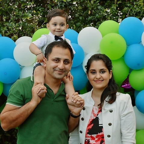 Khizer Baloch from Brisbane poses with his wife and son