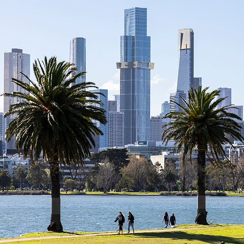 People are seen exercising at Albert Park Lake in Melbourne, ahead of a modest easing of COVID-19 restrictions.