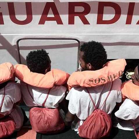 Some of the 629 migrants on board the rescue vessel in the Mediterranean