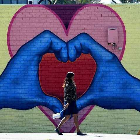 A heart-shaped mural is seen painted near a community services centre in Logan, south of Brisbane.