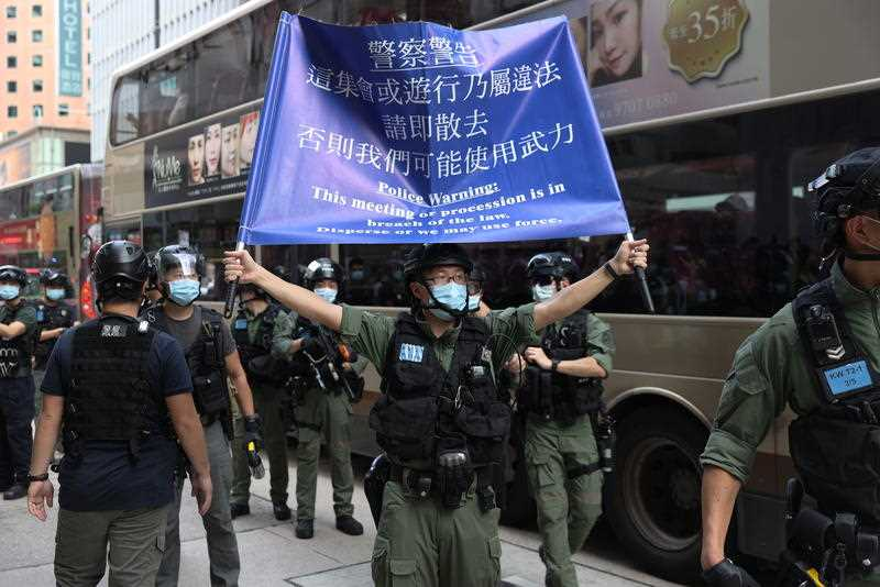Hong Kong police arrest hundreds at protests over election delay