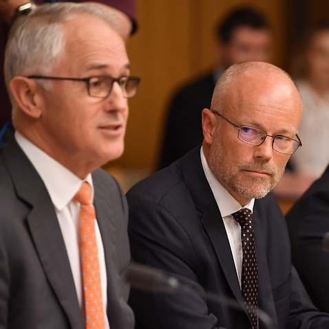 File image of special Adviser for the Prime Minister on Cyber Security Alastair MacGibbon (right) listening to Australia's Prime Minister Malcolm Turnbull