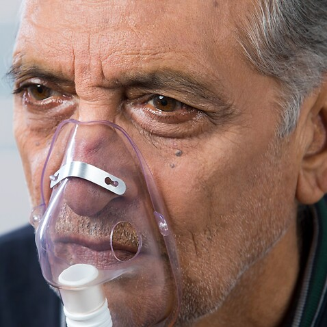 Representative image of an elderly person  receiving treatment for breathing difficulties