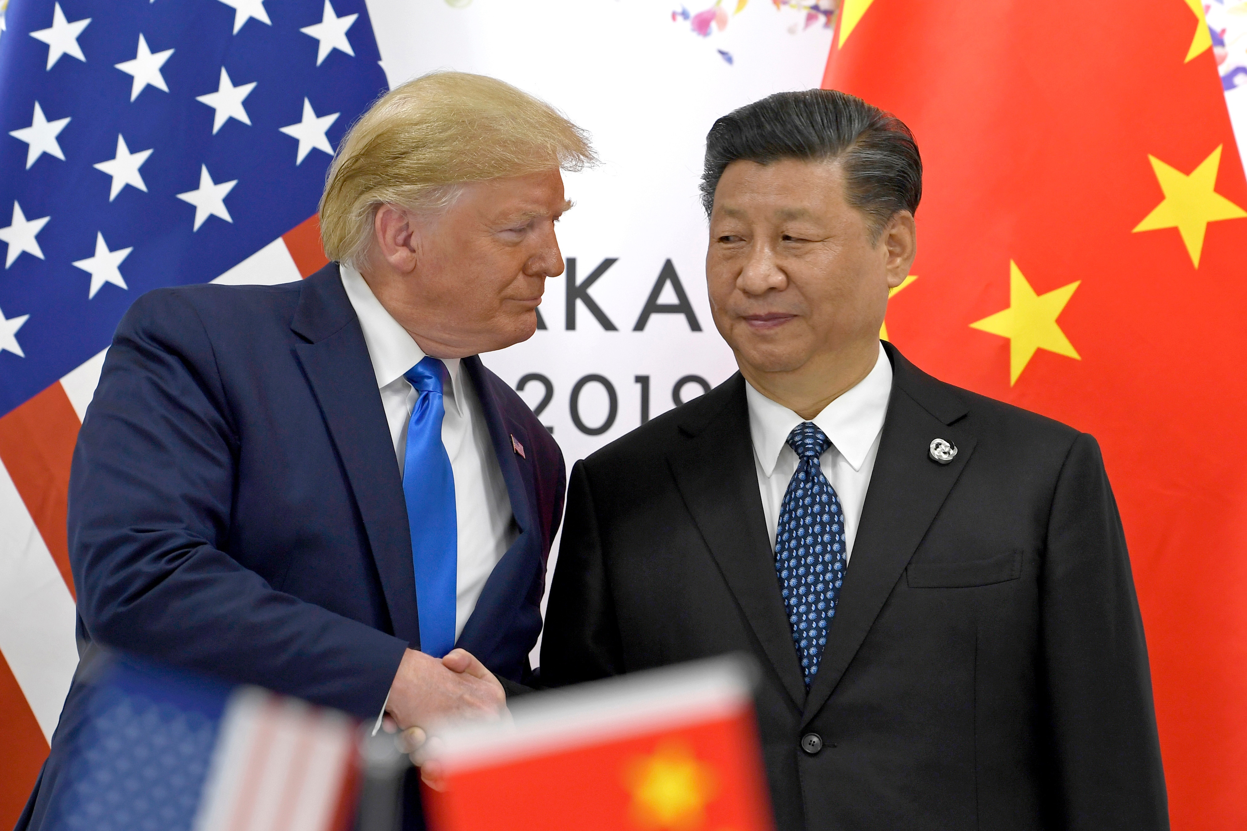 US President Donald Trump, left, shakes hands with Chinese President Xi Jinping during a meeting on the sidelines of the G-20 summit in Osaka, Japan.
