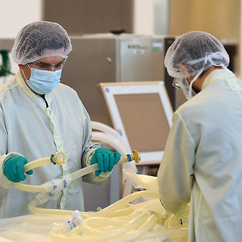 Scientists are seen at work inside of the CSL Biotech facility in Melbourne