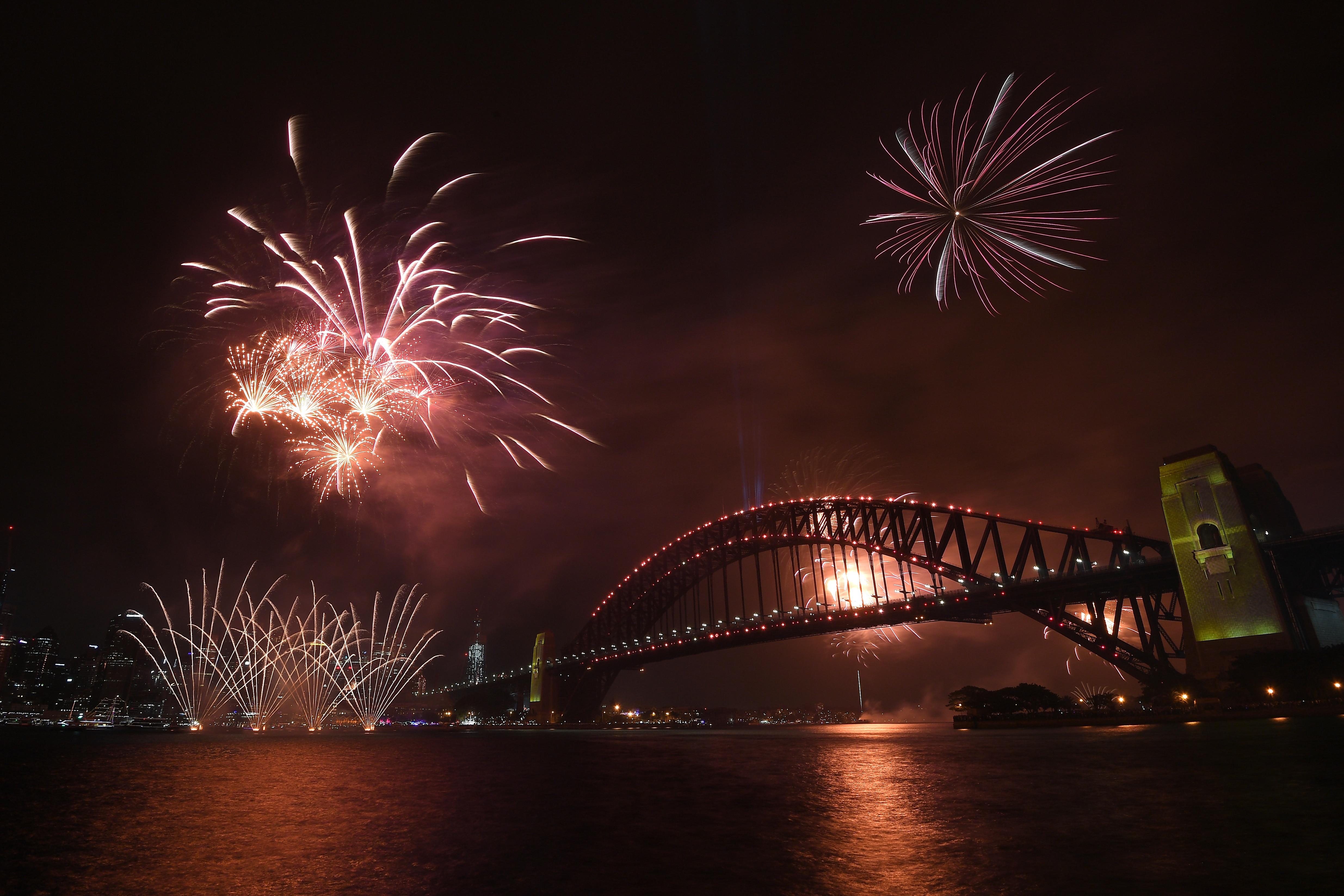 Fireworks explode above the Sydney Harbour Bridge.