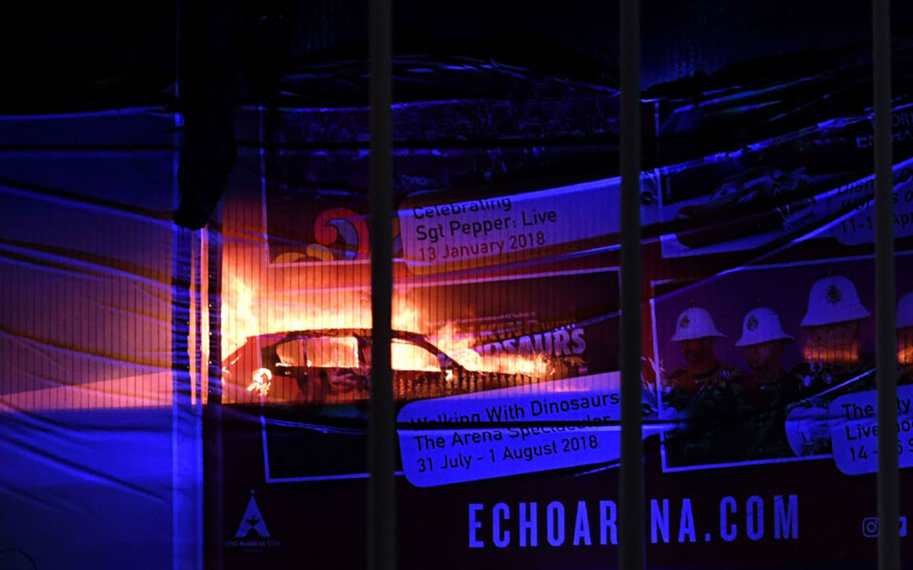 Cars burn during a blaze engulfing vechiles parked at a multi-storey car park near the Echo Arena, at the waterfront in Liverpool.