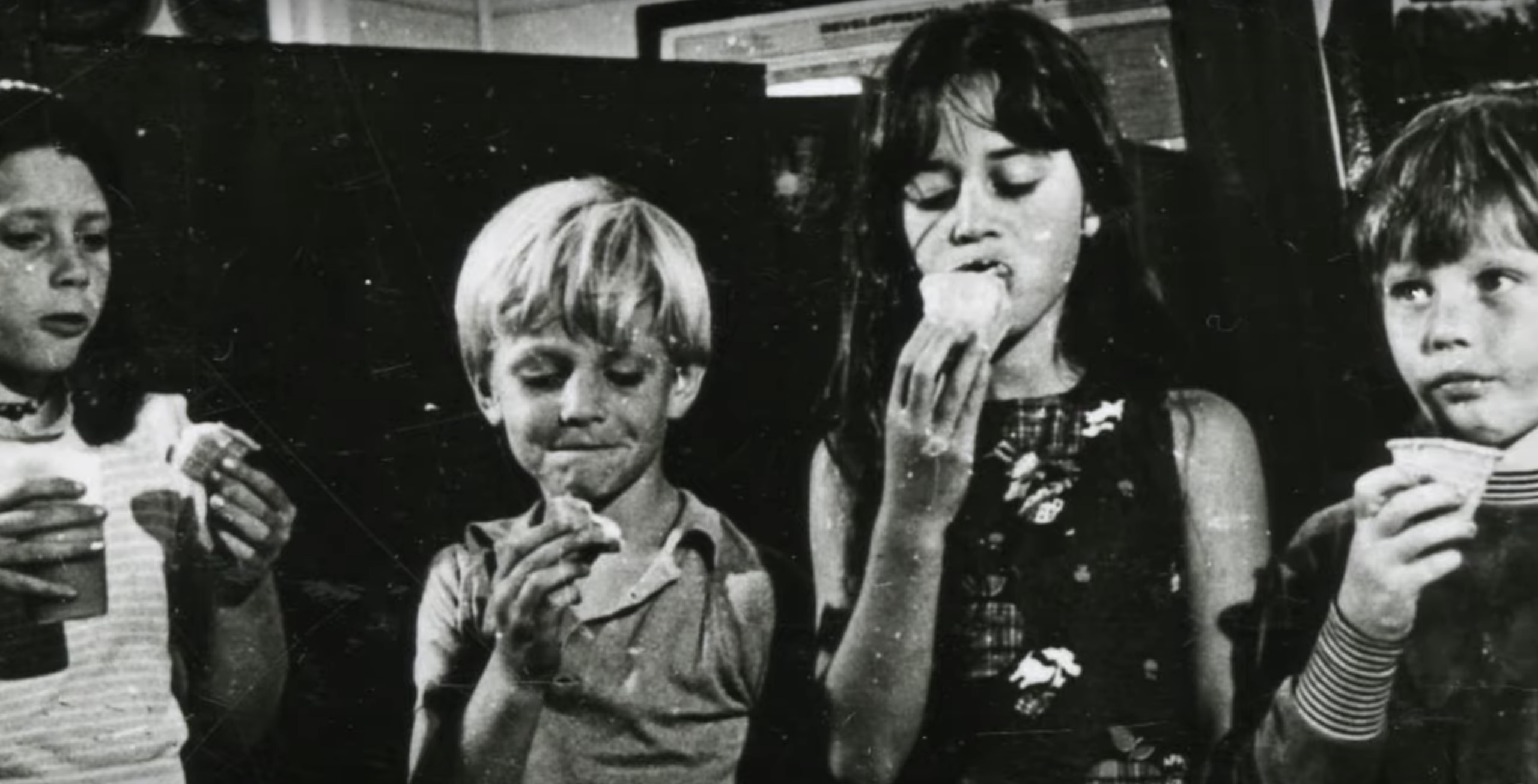 Some of the children enjoying some snacks after being rescued.