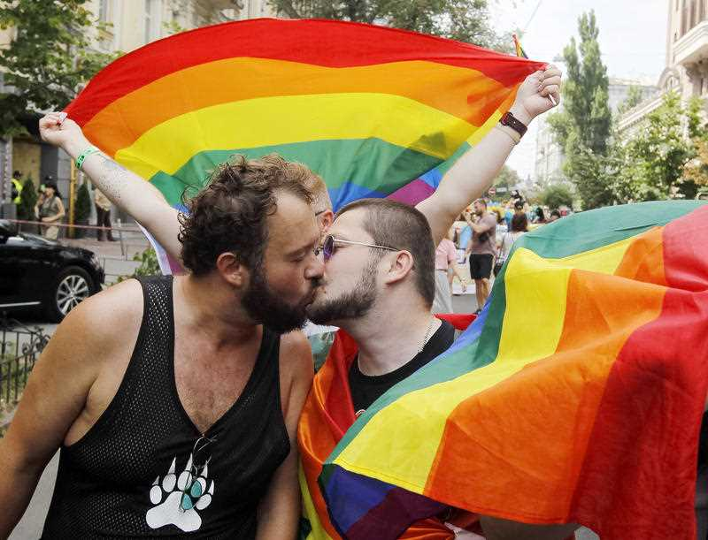 Participants kiss during a Gay pride parade or March of Equality in down town Kiev