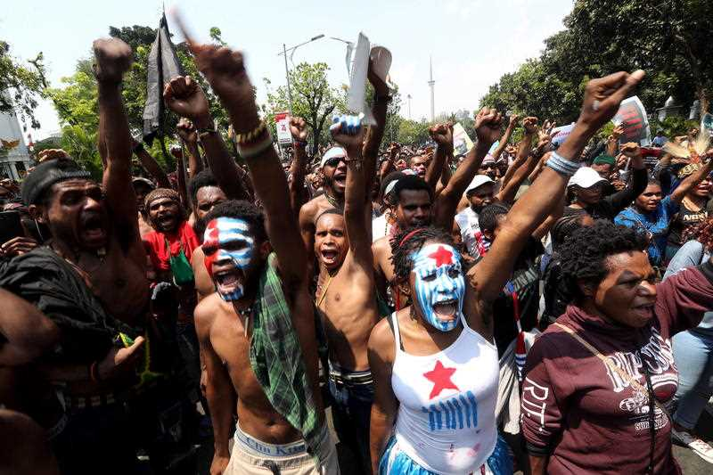 Papuan activists shout slogans during a rally in Jakarta, Indonesia.