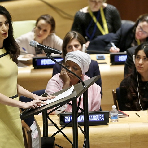 Human rights lawyer Amal Clooney, left, address a UN human rights meeting called