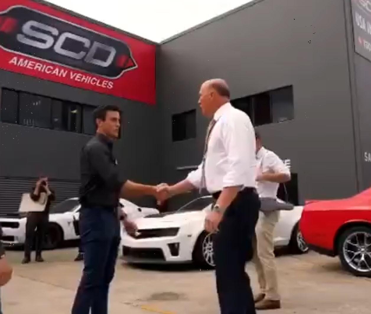 SCD American Vehicles Director Eddie Kocwa welcomes Peter Dutton to the Brisbane dealership.