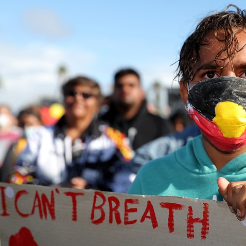 Protesters participate in a Black Lives Matter rally at Langley Park in Perth, Saturday, June 12, 2020. The protest is to raise awareness of Aboriginal Deaths in Custody. (AAP Image/Richard Wainwright) NO ARCHIVING