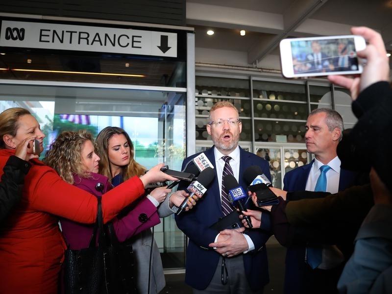 ABC Editorial Director Craig McMurtie (C)