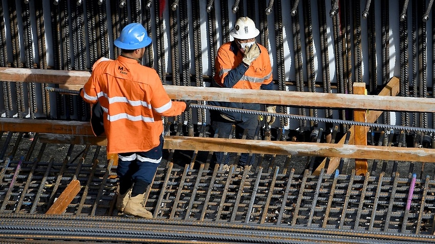 Construction workers are seen at the Barangaroo development site in Sydney on 19 August 2021.
