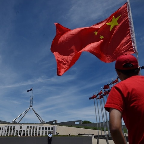 File image: A Chinese flag outside Parliament House in Canberra.