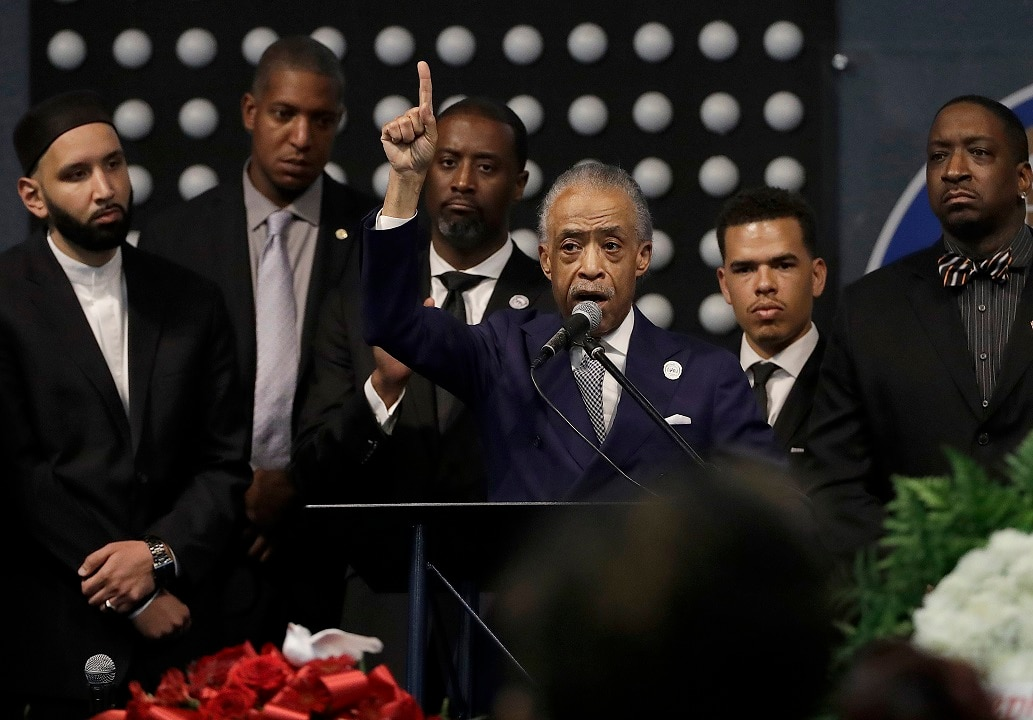 The Reverend Al Sharpton, centre, speaks to mourners at Stephon Clark's funeral.