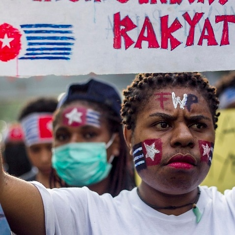 A Papuan student holds a banner which reads, 'Free Papuan People', during a rally in Surabaya, East Java, Indonesia.