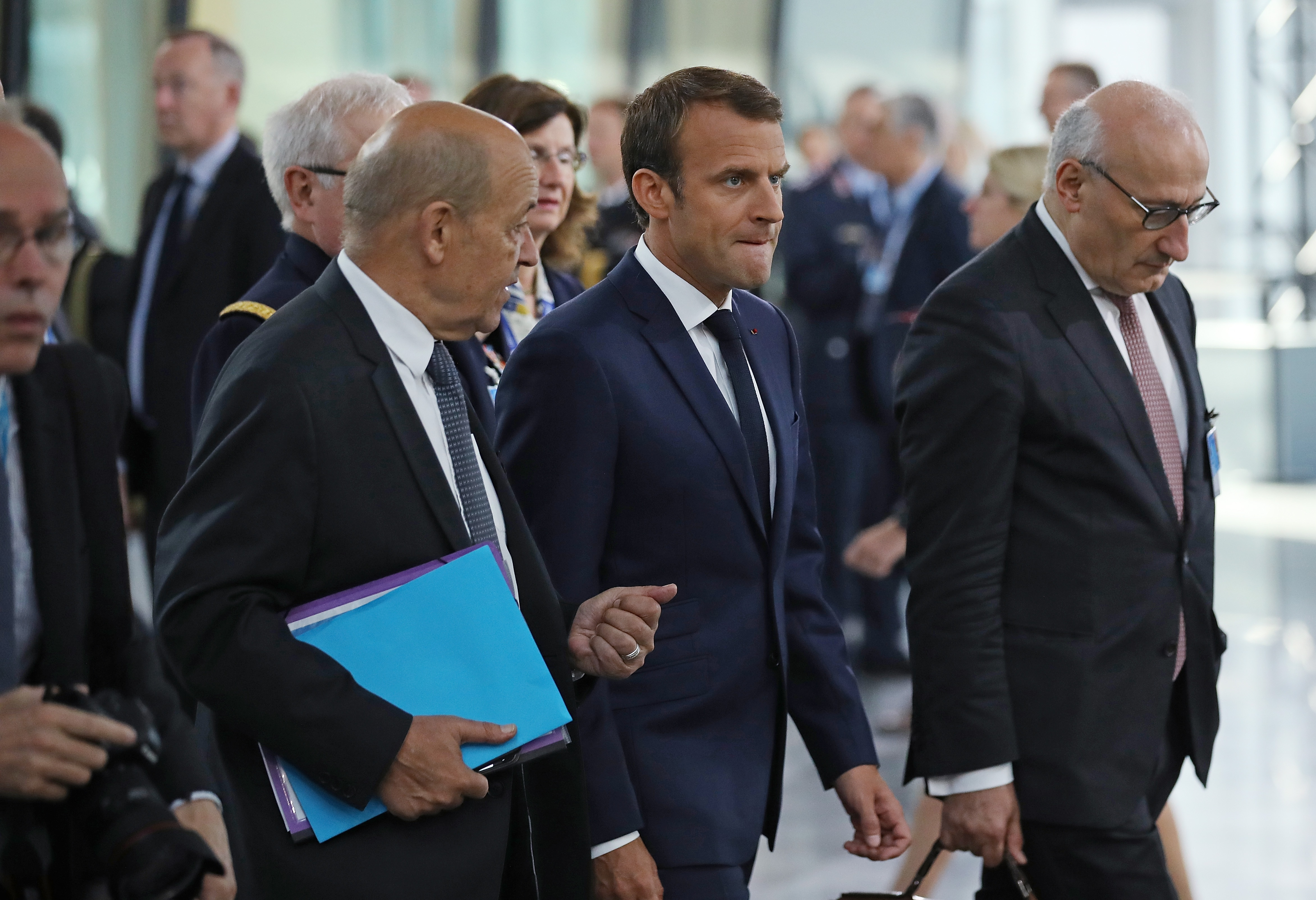 French President Emmanuel Macron arrives for a working session of NATO leaders in Brussels.
