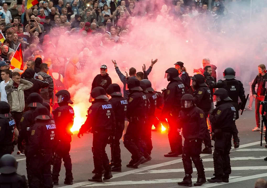 August 27, 2018: Protesters light fireworks during a far-right demonstration in Chemnitz, Germany.