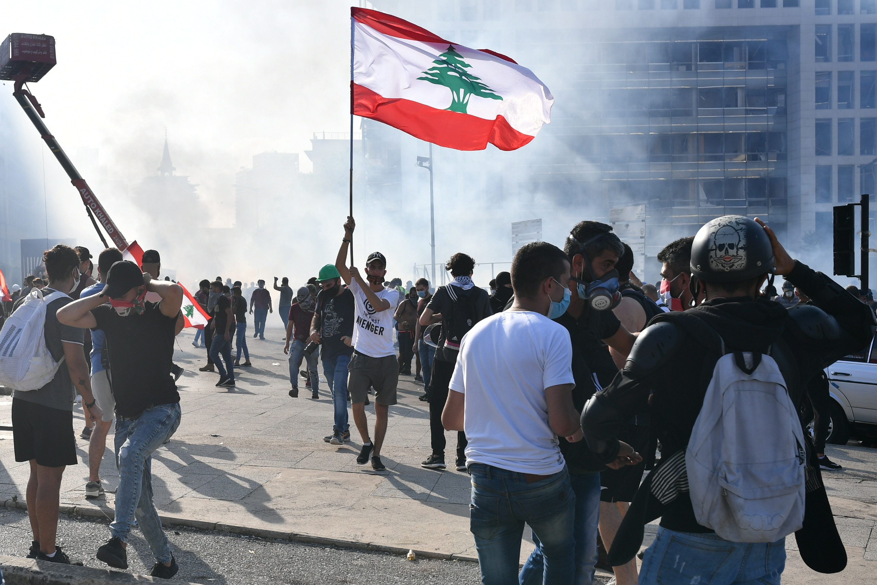 People take part in a protest in Beirut, demanding the resignation of the government led by Prime Minister Hassan Diab.