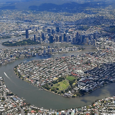 An aerial view of the Brisbane river and the city of Brisbane, Tuesday, November 14, 2017. (AAP Image/Dave Hunt) NO ARCHIVING