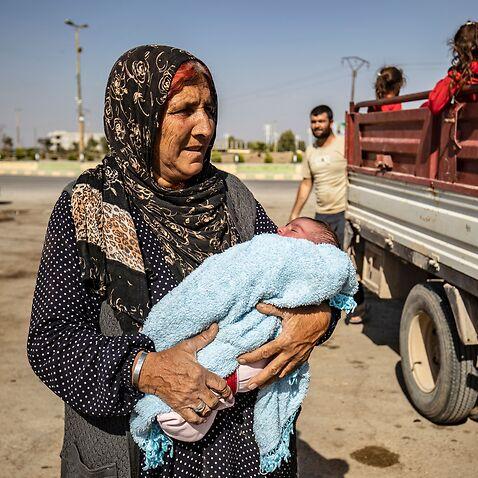 Syrian Arab and Kurdish civilians flee Turkish bombardment this week.