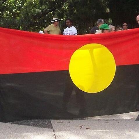 Aboriginal Flag - Invasion Day Rally and March, Parliament House, George St, Brisbane, Queensland, Australia 070126