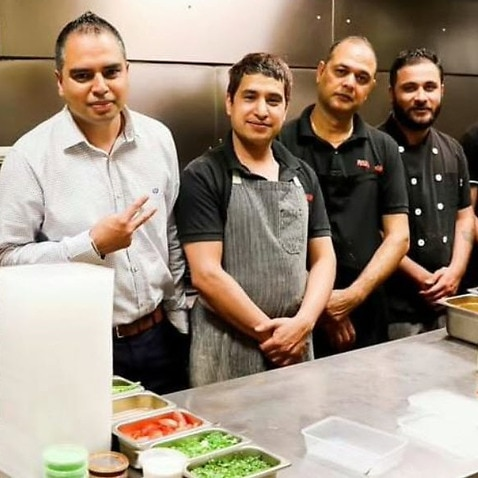 7 out of the 14 workers employed at Raj Singh's Punjabi Curry Cafe are international students.