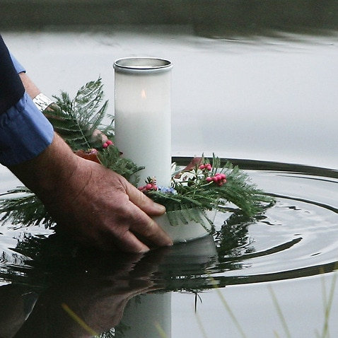 A floating candle in the reflection pool at the memorial site at Port Arthur.
