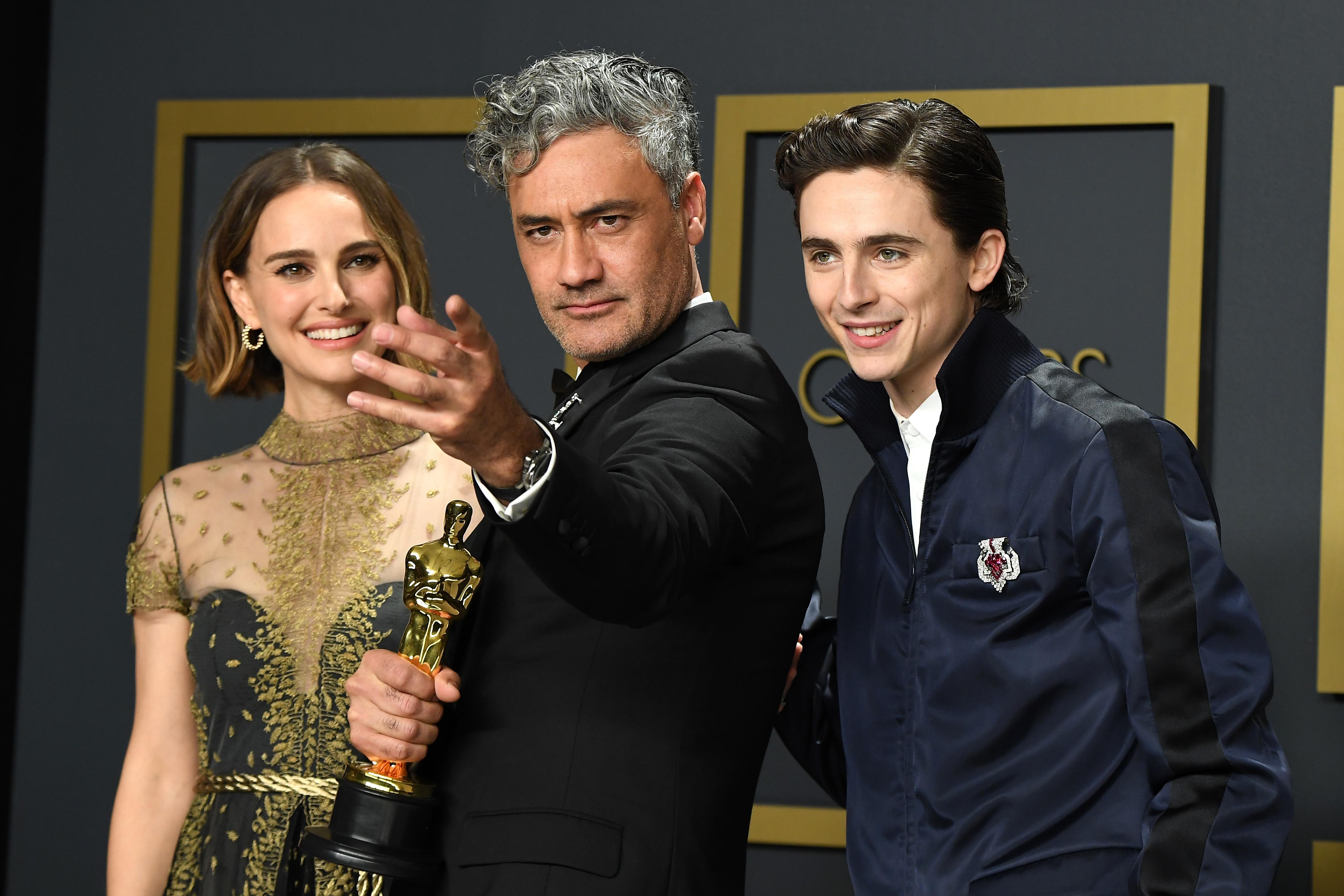 Natlie Portman, Taika Waititi, winner of the Adapted Screenplay award for Jojo Rabbit  and Timothee Chalamet pose in the press room.