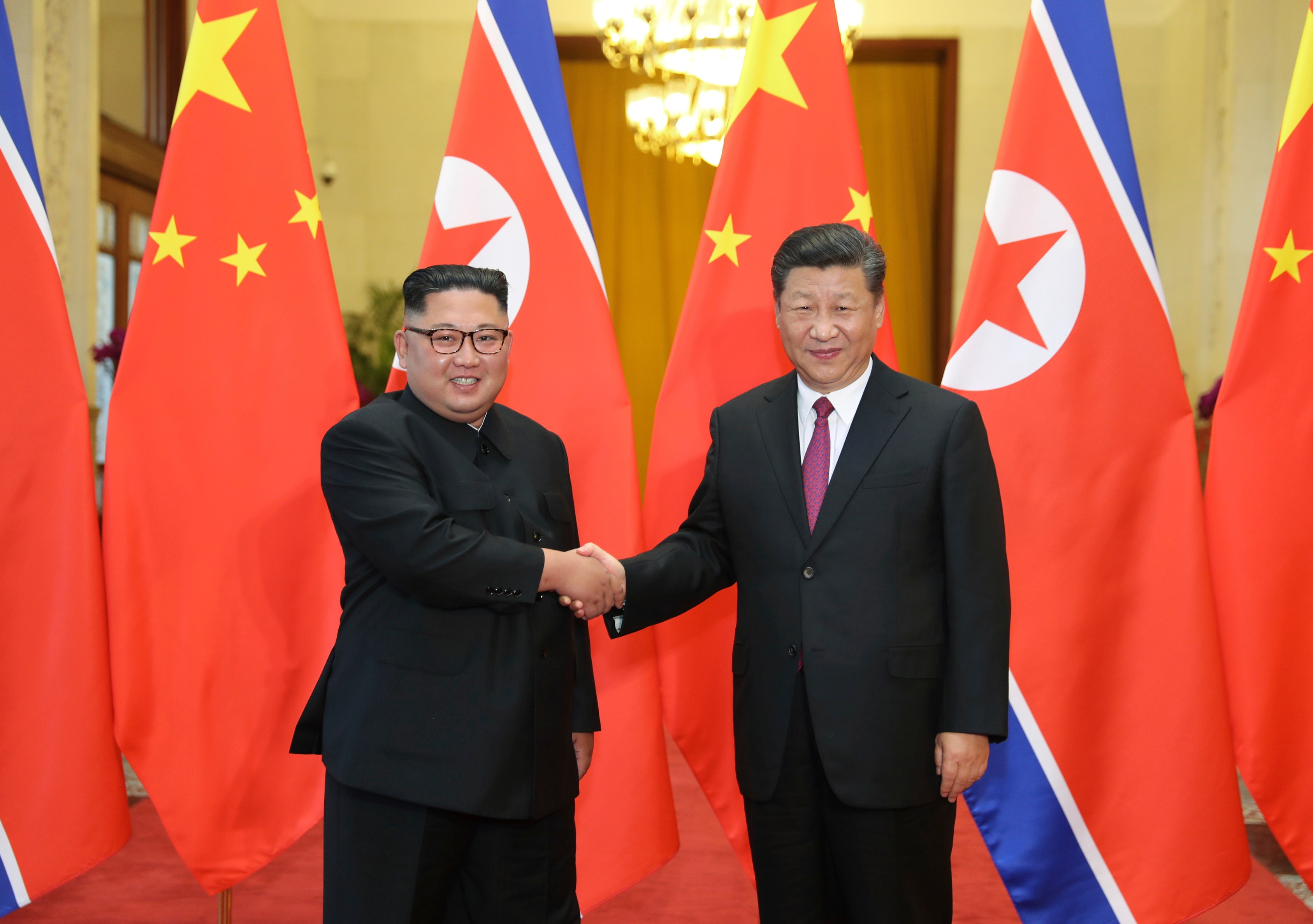 In 2018, Chinese President Xi Jinping poses with North Korean leader Kim Jong-un during a welcome ceremony at the Great Hall of the People in Beijing.