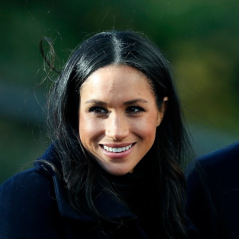 FILE - In this file photo dated Friday, Dec. 1, 2017, Britain's Prince Harry and his fiancee Meghan Markle, in Nottingham