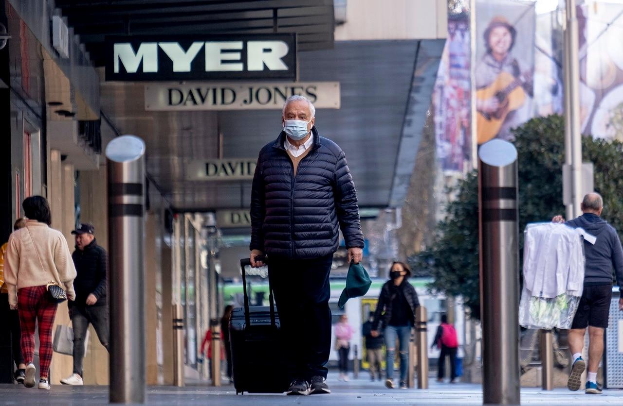 People wear masks in Melbourne on Thursday.