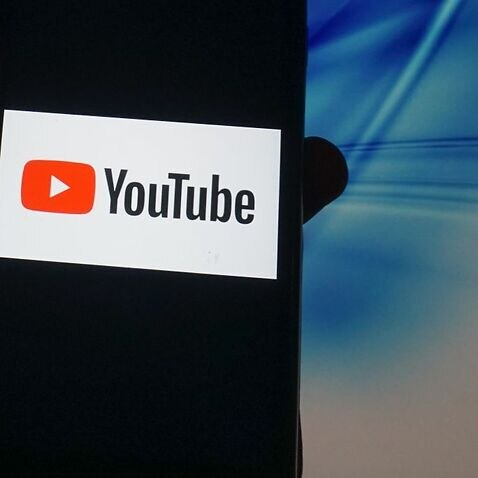 A YouTube logo is seen displayed on a smartphone in London 14 November 2020.