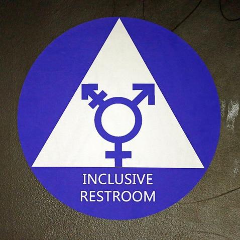 A gender neutral bathroom sticker