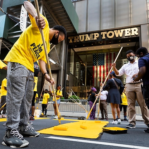 Black Lives Matter is painted on Fifth Avenue in front of Trump Tower, Thursday, July 9, 2020, in New York. (AP Photo/Mark Lennihan)