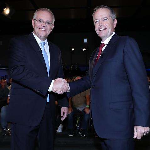 Prime Minister Scott Morrison (left) and Leader of the Opposition Bill Shorten shake hands before the People's Forum debate in Brisbane.