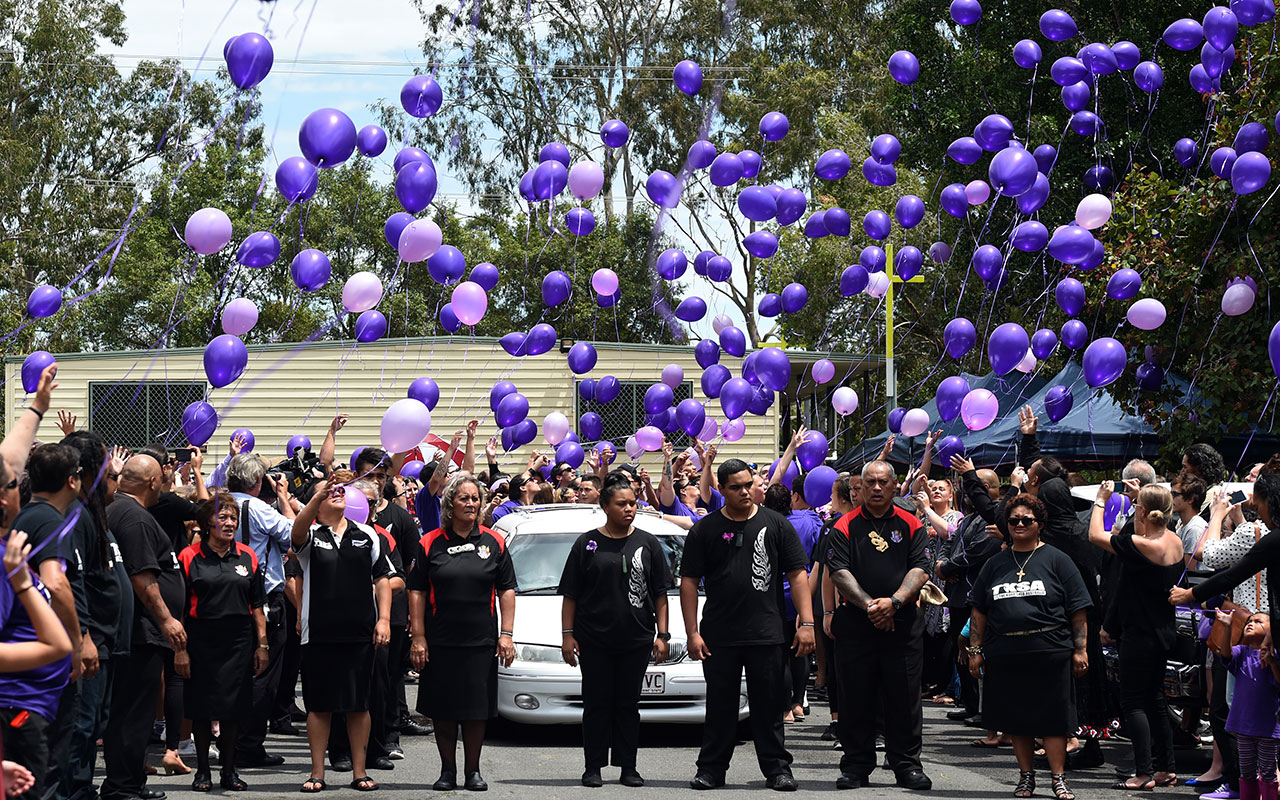 Mourners release balloons at the conclusion of the funeral service for murdered school girl Tiahleigh Palmer in Cornubia, south of Brisbane, November 2015