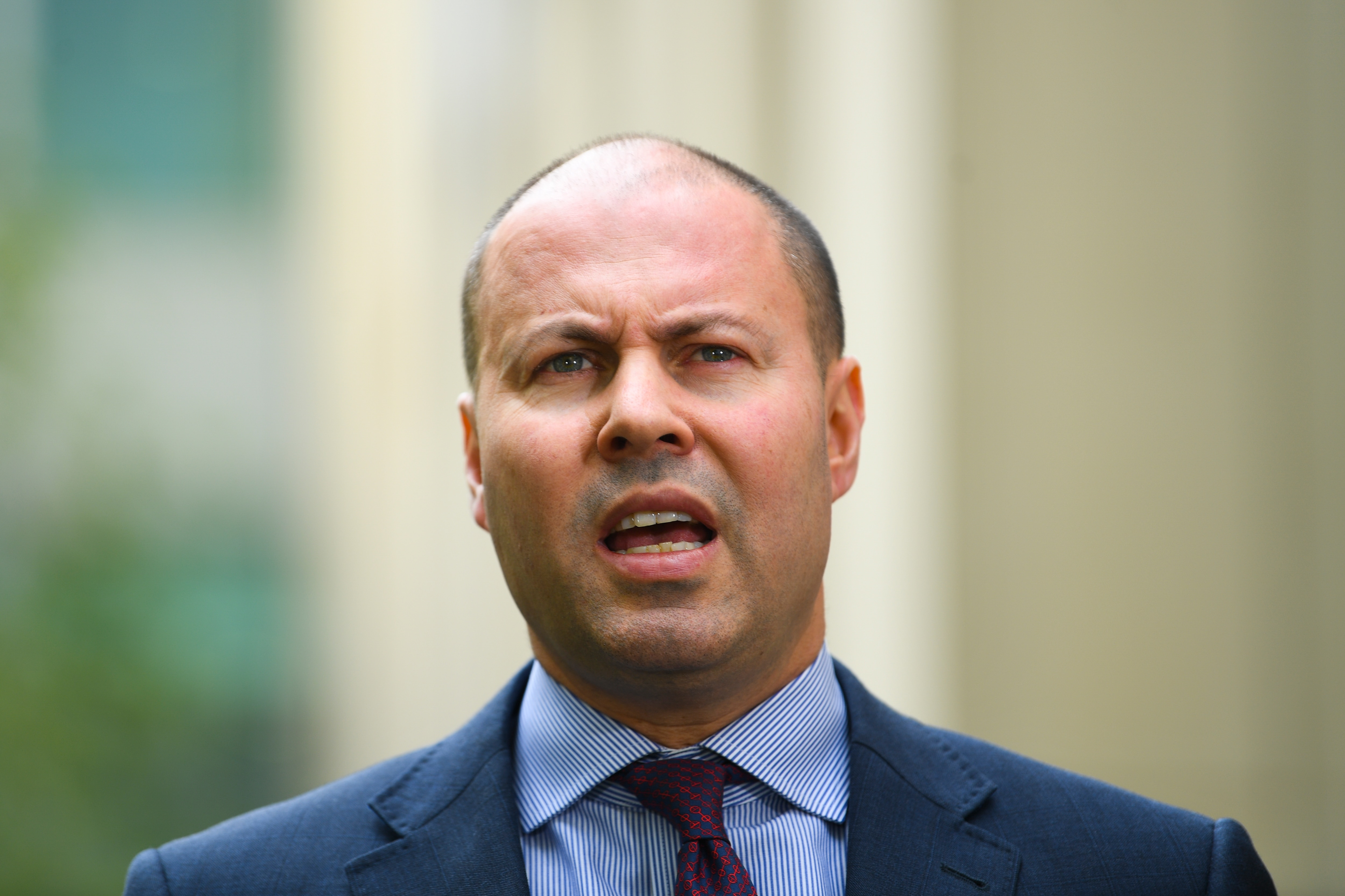Treasurer Josh Frydenberg speaks to the media during a press conference at Parliament House in Canberra.