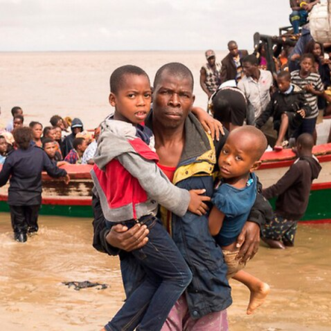 Survivors of Cyclone Idai arrive by rescue boat in Beira, Mozambique
