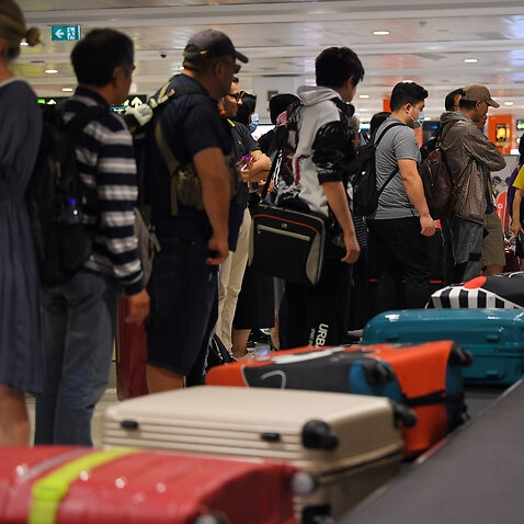 Passengers arriving on flights into Australia will be forced to self-isolate for two weeks under new restrictions announced by the prime minister.