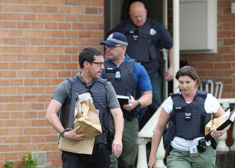 Police take items from the Coolaroo home.