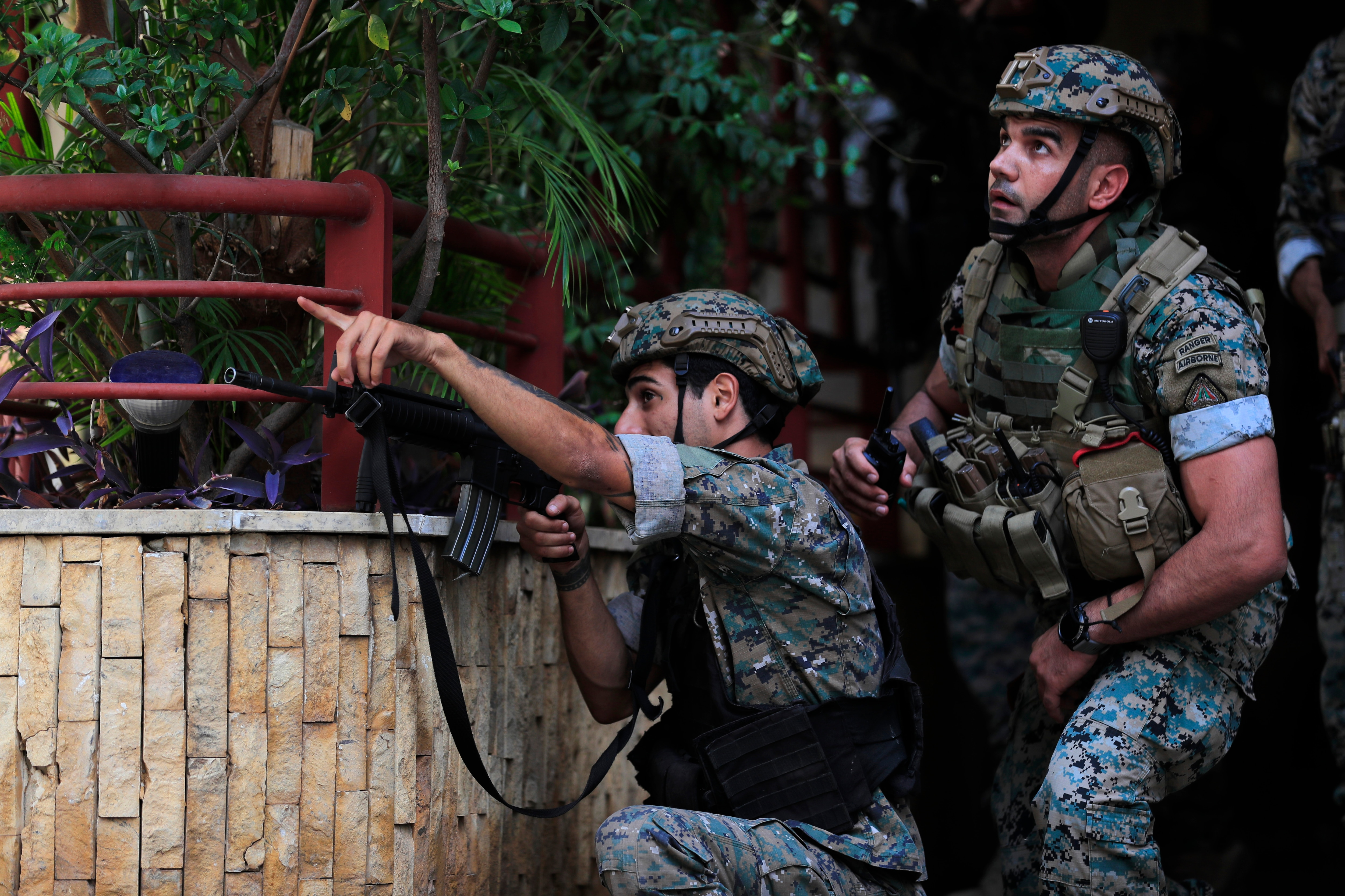 Lebanese security forces react to gunfire during a protest in Beirut