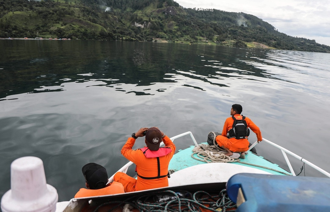 An Indonesian search and rescue team look for victims from the sunken boat.