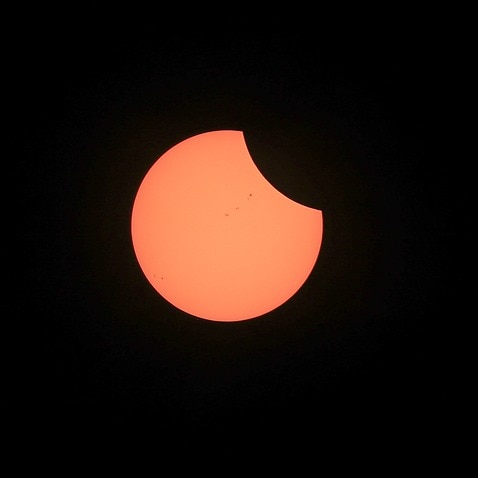 The moon starts its path across the sun before the start of a total solar eclipse