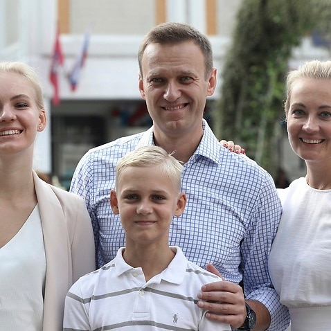 A file photo of Alexei Navalny, with his wife Yulia, daughter Daria, and son Zakhar