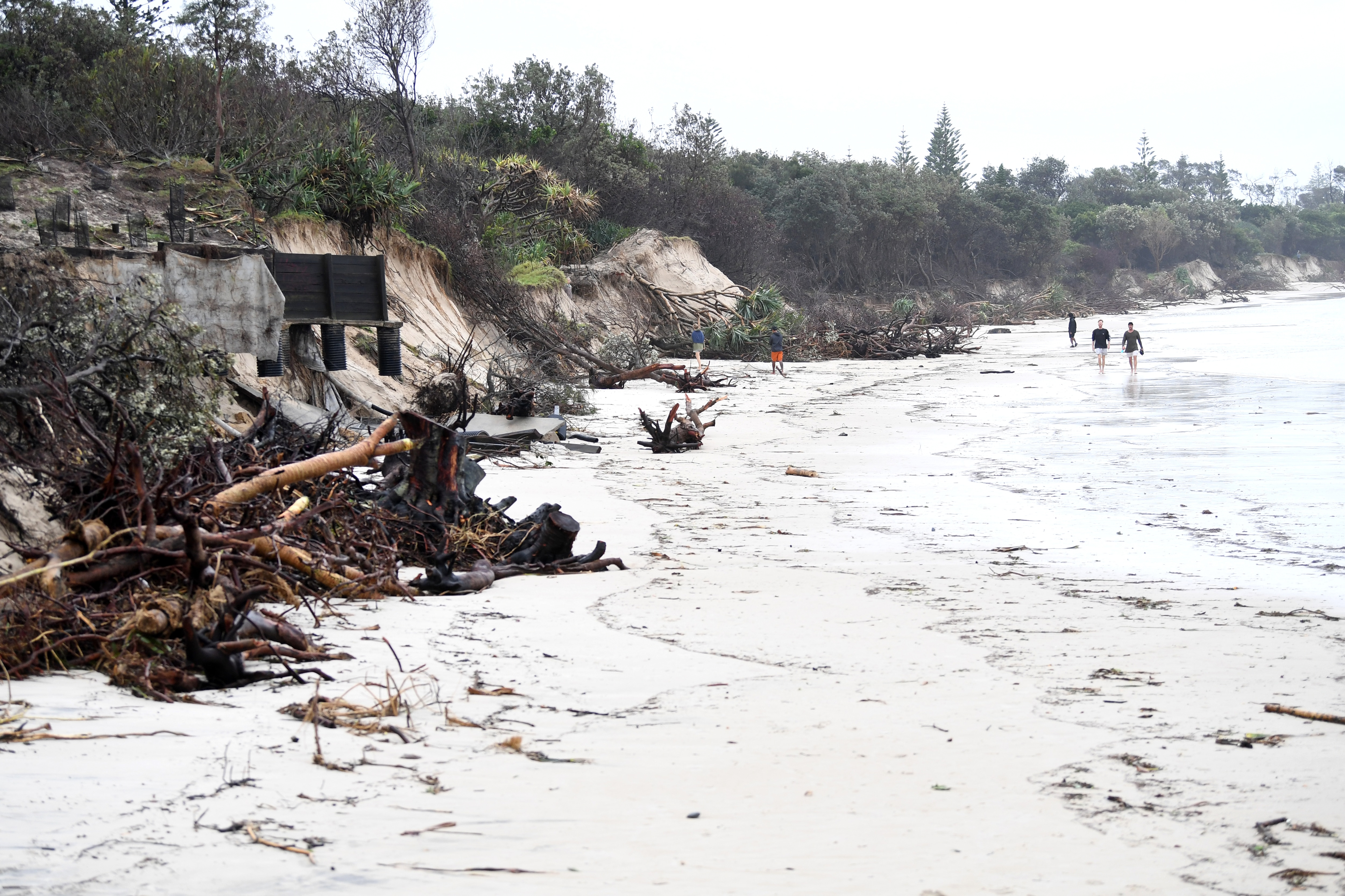 Locals inspect erosion damage to Clarkes Beach at Byron Bay, NSW, on 14 December, 2020.